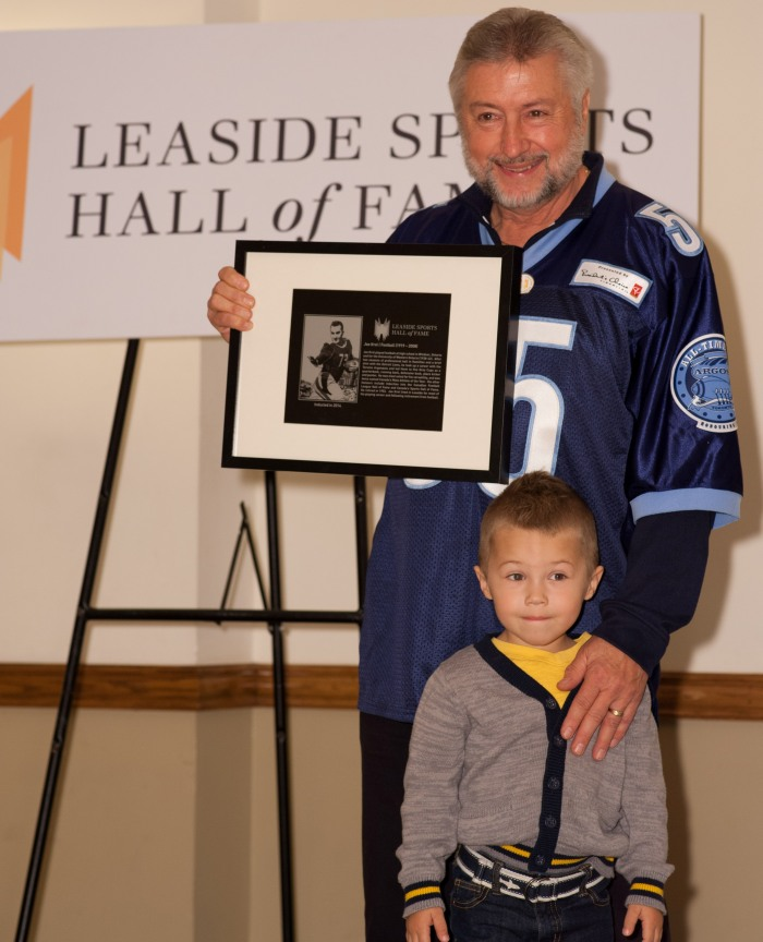 Peter Krol and grandson Preston accepting the plaque for 2014 inductee Joe Krol